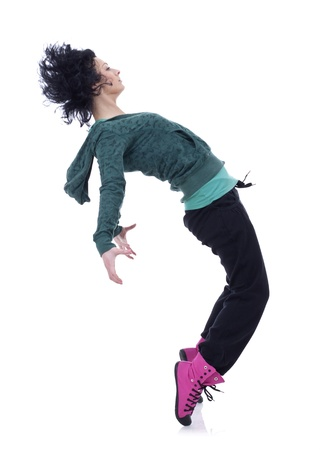 Teenage girl dancing hip-hop leaning on back, over white  photo