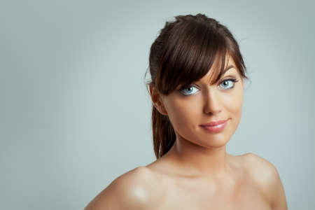 bared: Beautiful young woman face with clean skin Stock Photo