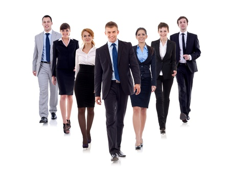 Business team walking forward - leadership and teamwork concepts using a group of businessmen and businesswomen isolated on white photo