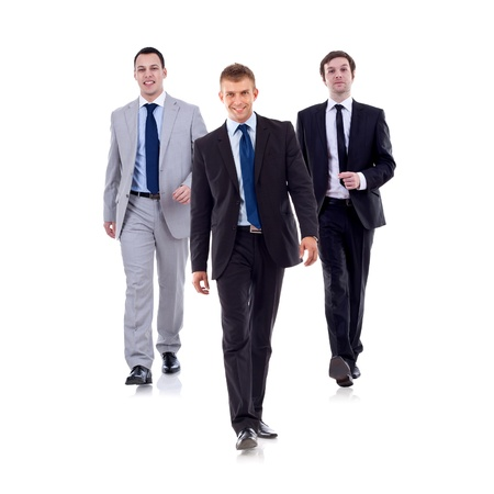 Business team walking - leadership and teamwork concepts using a group of businessmen isolated on white  photo