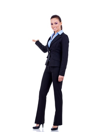 Business woman points at something in her back. Isolated on white background  photo