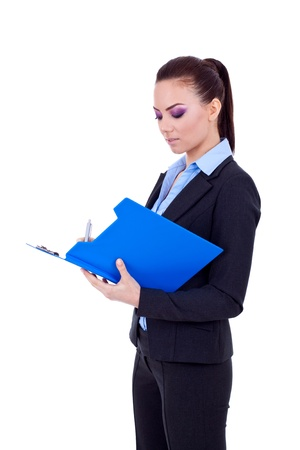 Business woman writing on a clipboard, isolated on a white background.  photo