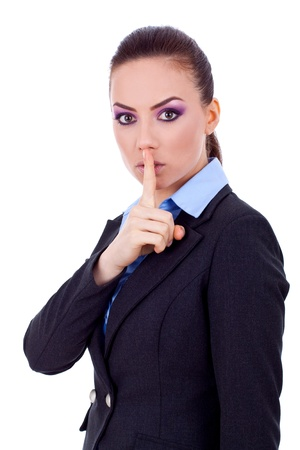 Image of business lady in suit holding her finger near the mouth  photo