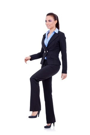 Young attractive business woman stepping on imaginary step  Stock Photo - 8936913