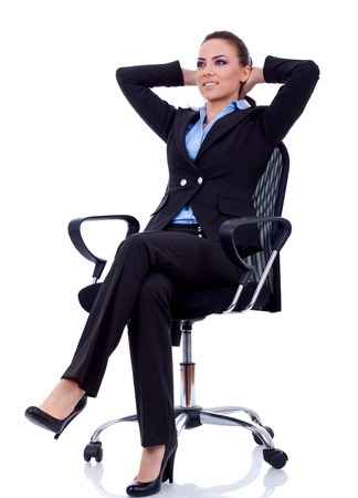 business woman leaning back in a black chair dreaming Stock Photo - 8938610