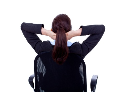 Satisfied business woman with hands crossed behind her head Stock Photo - 8936985
