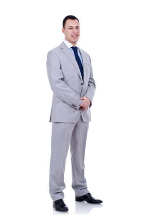 Full length portrait of a young businessman standing on white background Stock Photo - 8933171