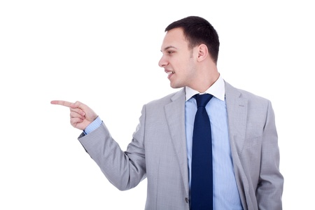 finger tip: Happy business man pointing to the side with his forefinger