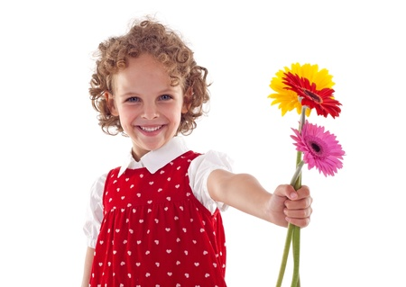blonde mom: Smiling little girl giving flowers for mothers day, isolated Stock Photo