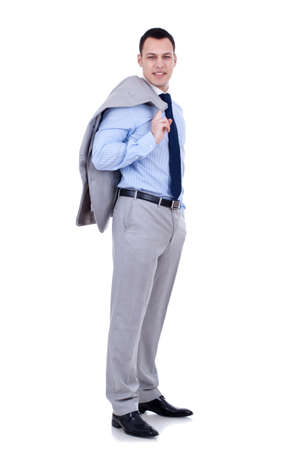 over shoulders:  Full length of a relaxed young business man holding coat over shoulders isolated on white background