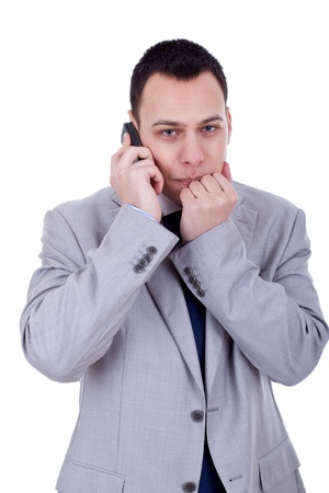afraid looking business man with a phone isolated on white  photo