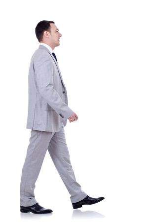 picture of a young business man walking forward - side view Stock Photo - 8936936
