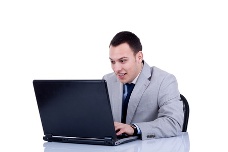 young man surprised and happy with something he see on his laptop Stock Photo - 8936982