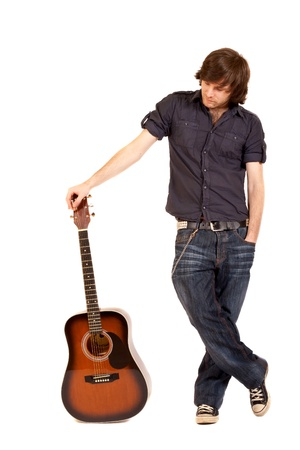 rock guitarist: picture of a guitarist with acoustic guitar over white Stock Photo