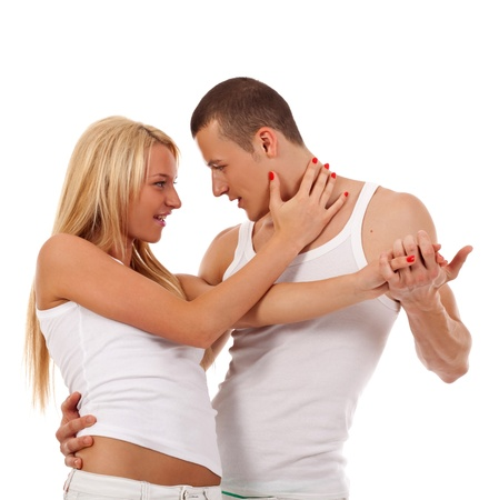 young couple dancing - man holding his girlfriend in a dance position photo