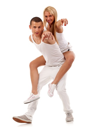 couple having fun pointing at the camera over a white background photo