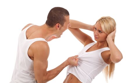 Domestic violence - picture of a man screaming and pulling his girlfriends shirt  photo