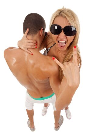 dynamic picture of a casual young couple, she is making a rock gesture photo