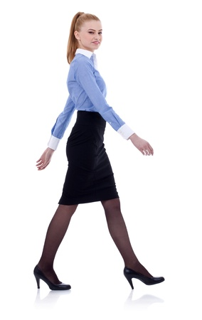 midlife: Fullbody business woman walking, isolated on white