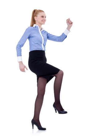 climbing stairs: Mujer de negocios subir escaleras imaginarios. Aislados en blanco Foto de archivo
