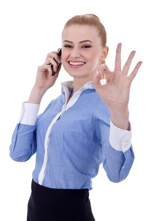 approvement: Happy business woman with phone and ok gesture, isolated