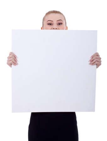 Beautiful blonde business woman holding a blank billboard. Isolated on white Stock Photo - 9044405