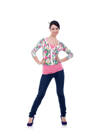 Full body young woman in casual clothes, relaxed pose, isolated over a white background.  Stock Photo - 9044400