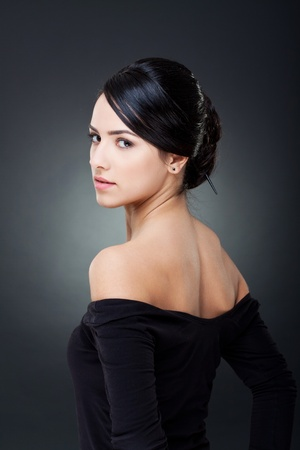 Fashionable photo of elegant girl with nice hairstyle photo