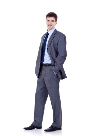 Full length of a handsome business man standing with hands in pocket against white  Stock Photo - 9044421