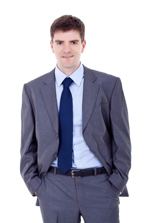 Portrait of a smiling business man standing with his hands in the pockets photo