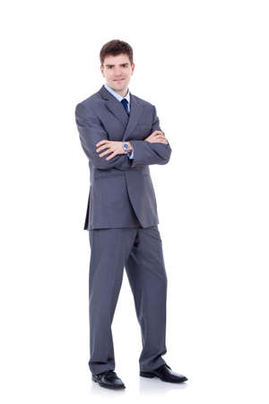 Full length portrait of a successful business man with hands folded isolated on white Stock Photo - 9044417