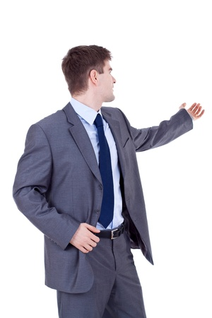 portrait of a young business man holding his arm out presenting something. Room to add an object, or some text Stock Photo - 9076797