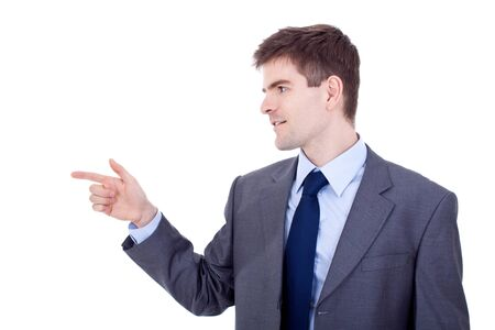 Handsome young business man pointing to his right side Stock Photo - 9076798