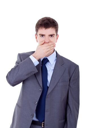 business man making the speak no evil gesture over white  photo