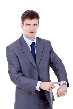 watch over: business man looking and pointing at his watch over white