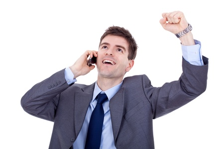 happy business man with cellular phone winning over white  photo