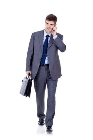 businessman phone: Business man Walking forward while talking on the phone over white