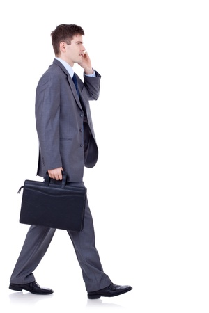 side view of a hurrying business man talking on the mobile phone Stock Photo - 9044426
