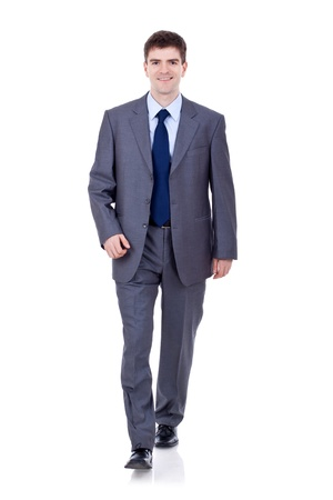 Business man walking and looking to the camera isolated on white Stock Photo - 9044422
