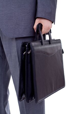 side job: Low section image of a business person holding a suitcase  Stock Photo