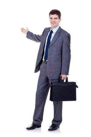Happy business man with briefcase presenting and showing with copy space for your text isolated on white background Stock Photo - 9076537