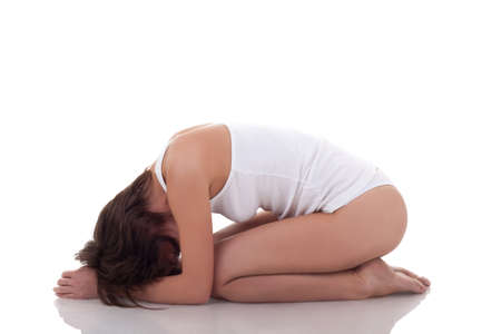 fit woman in white underwear practicing yoga over white photo
