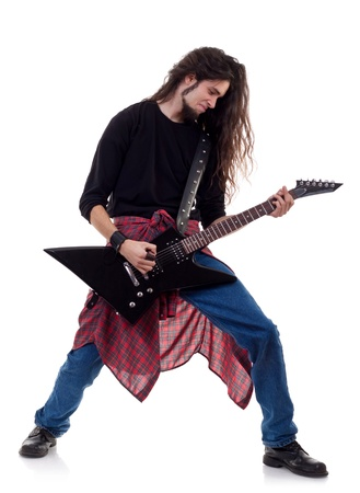 heavy metal guitarist playing the guitar isolated over white background  photo