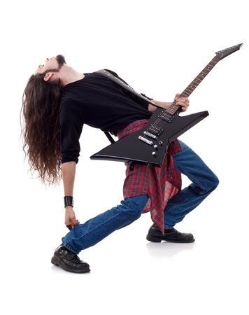 heavy metal: long haired guitarist is playing a guitar isolated over white background