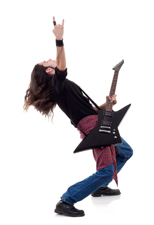 long haired guitarist is playing and making a rock hand gesture  Stock Photo