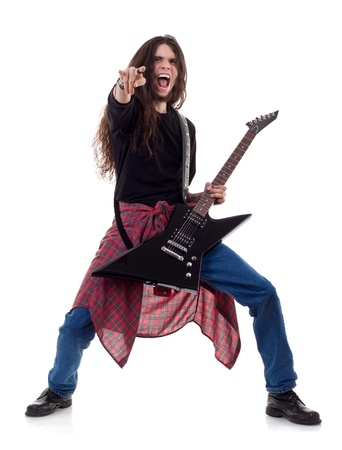 heavy metal guitarist making a rock and roll gesture while screaming and playing