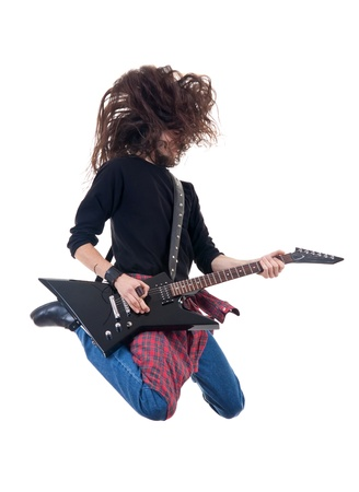 passionate heavy metal guitarist jumps in the air over white  Stock Photo - 9044414
