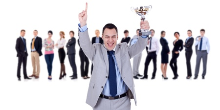 winning businessteam with male executive holding a gold trophy  photo