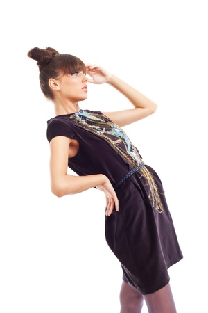 beautiful fashion model in a dark colour dress posing for the camer photo