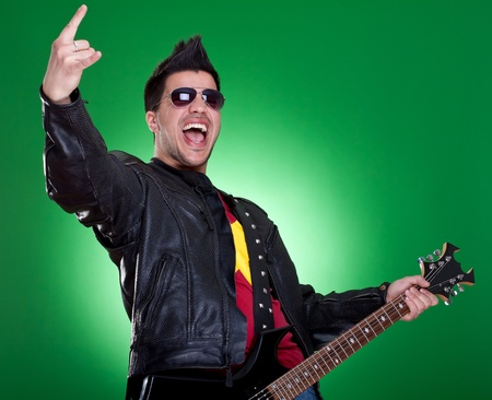 heavy metal guitarist making a rock and roll gesture while screaming and playing  photo